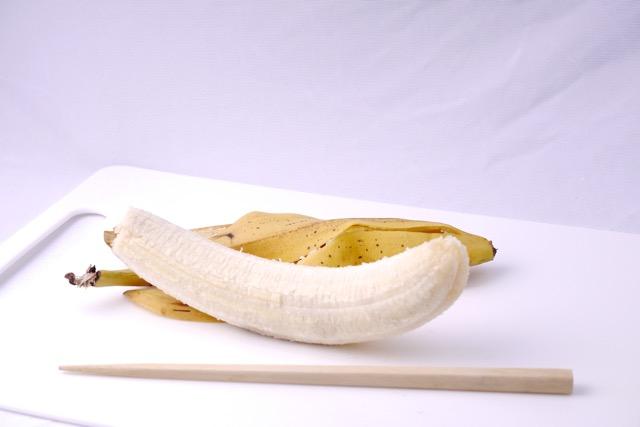 Peeled banana with chopstick
