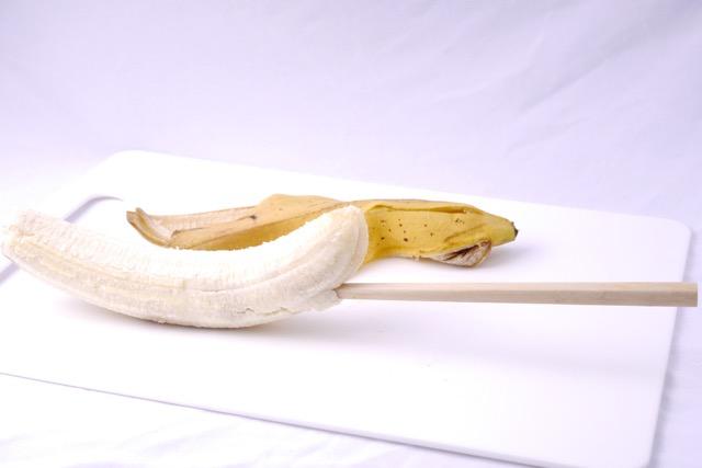 Insert chopstick into banana