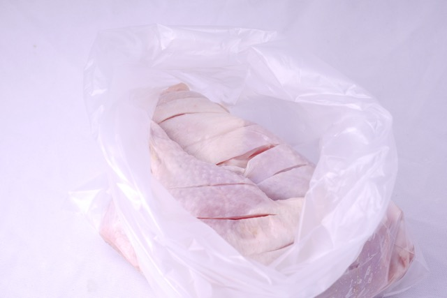Place chicken in a plastic bag