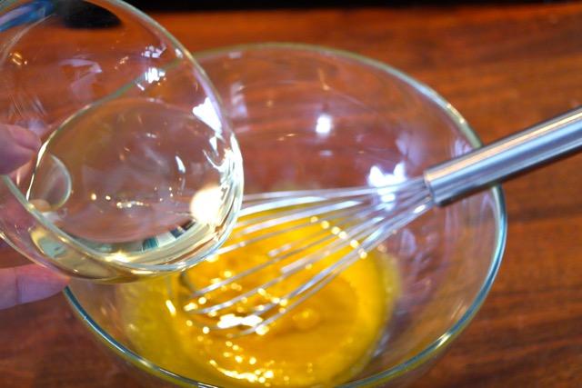 Add oil into egg yolk