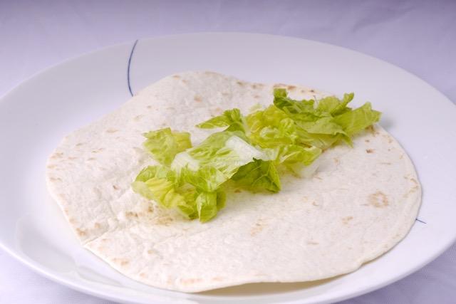 Flour tortilla with salad leaf