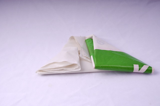 Fold the other side into a triangle 2