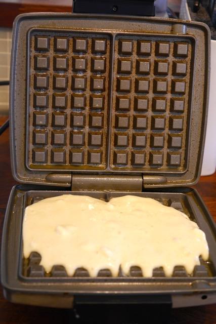 Pour waffle batter
