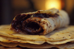 A sweet crepe blessed with a generous amount of chocolate.