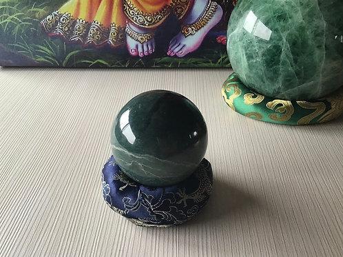 Serpentine crystal ball (.33lbs) w/silk cushion
