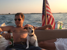 A MAN HIS BEER AND A DOG
