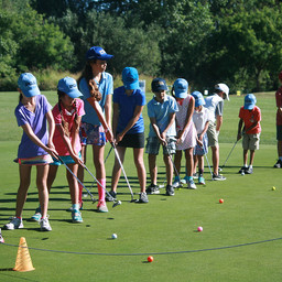 Junior golfers practice putting