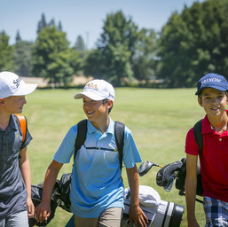 Group of junior golfers on the course