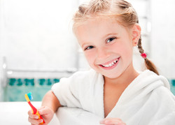 Little girl brushing teeth in bath.jpg