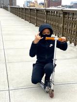 Izzy rolling across the Longfellow Bridge