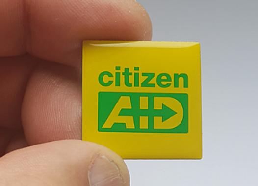 citizenAID lapel badge