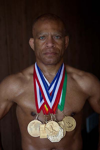 Lee_Kemp_with_his_7_gold_medals.jpg