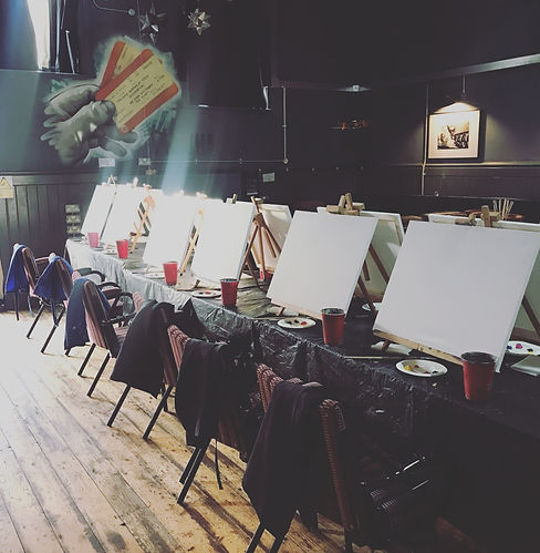 A row of blak canvases waiting for their artist.