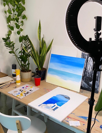 In our studio working on new paintings released every month