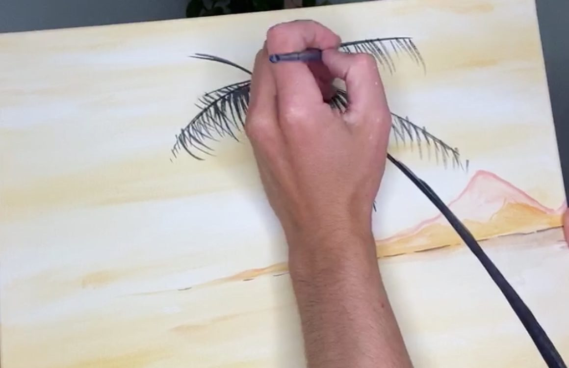 A close up of how to paint a palm tree