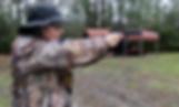 woman pointing gun at target
