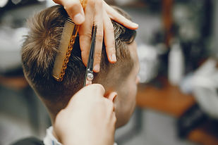 man-cuts-hair-barbershop_1157-15957.jpg