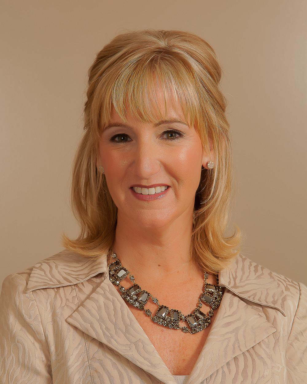 Headshot of Christine Palmer Hennigan.