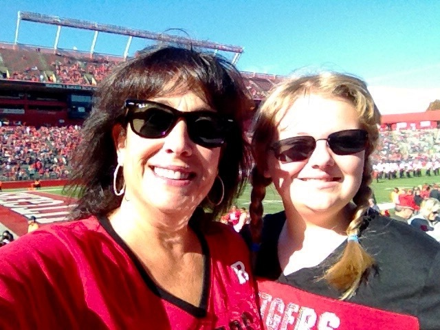 A child and her mentor at a sporting event,