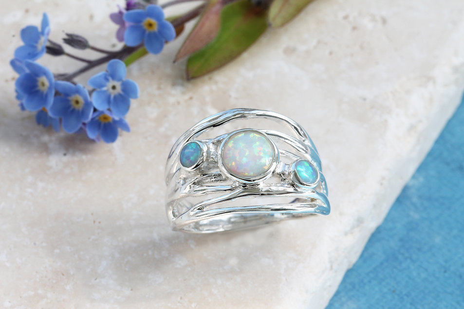 Isla Silver handmade silver chunky ring with two blue opals and one white opal