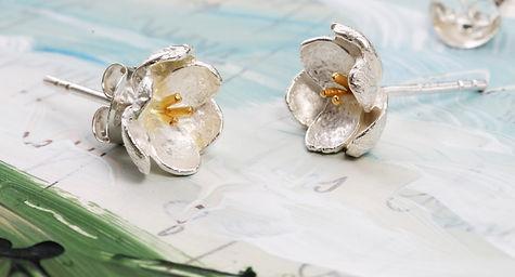 Isla Silver handmade silver flower stud earrings with gold stamens