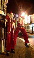 Christmas themed Entertainment 10ft Santa, stilt walkers, stilt walking father christmas, Street theater Lincolnshire Earthbound Misfits