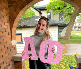 Daniela T. holding our letters!