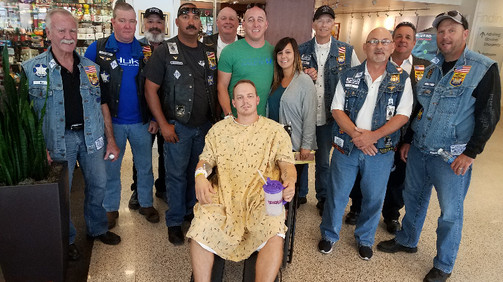 Injured Phx Officer Wolfenden Receives Donation from AZ Choir Boys