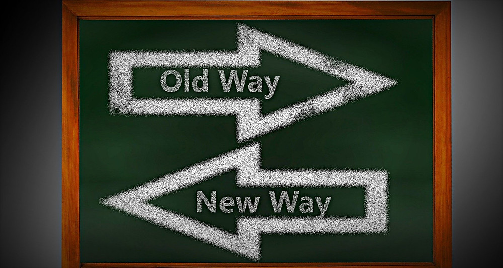 sign with old way and new way pointing different directions