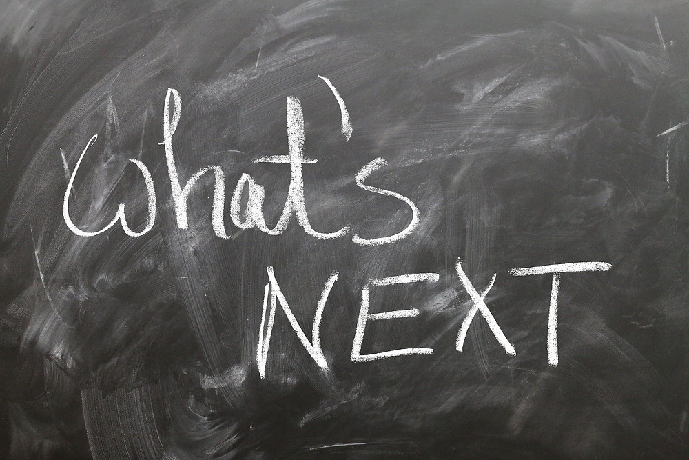 a chalkboard with the words: what's next written on it