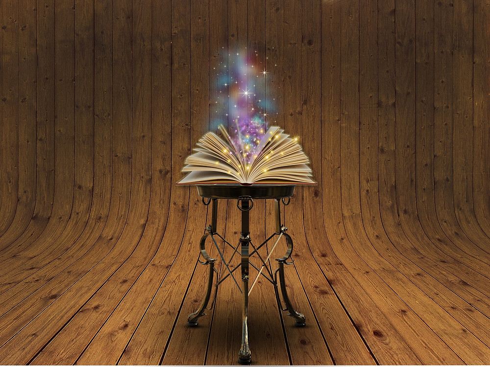 an open book on a stool with stars coming out of it