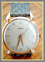 Alpha -  Solid 18K Yellow Gold, 17 Jewels, Curved Tear Drop Lugs featuring a High Quality Mechanical Wind Movement Wristwatch - (circa 1940s)