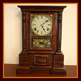 Atkins Clock Company, Bristol, CT. - 'London' Model - Solid Rosewood Case - 8 Day Mechanical Movement - Unbelievable Overall Original Condition - Shelf Clock - (circa 1863 - 1876)