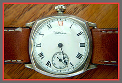 Waltham - Three Part Nickel Silver Fancy Engraved Case with the Crown at the 12 o'clock position, Porcelain Dial with Roman Numeral Hour Makers featuring the XII Marked in Red, a 60 Seconds Sunken Sub-Dial Wristwatch - (circa 1908)
