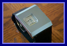 Buler - Square Raised Off-Center Crystal, Jump Hour, With a High Gloss Chrome Tapered Case - Wristwatch - (circa 1970s)
