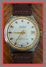 Nordam - Brushed Aluminum Dial with a Gold Rope Textured Bezel and Raised Gold Baton Hour Markers with a Red Colored Center Section - Wristwatch - (circa 1970s)