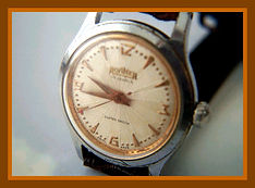 Roamer - Super Exploding Starburst Dial Featuring Mod Style Arabic Numerals with a Very High Quality 17 Jewel Movement Wristwatch (circa 1950s)