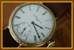 Elgin - Transitional 10K Gold Filled Fancy Engraved Wristwatch with a Porcelain Dial and a Large Sunken Sub-Dial in Fantastic Condition - (circa 1903)