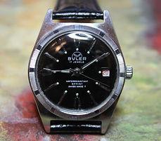 Buler - Thunderbird Style Case - Jet Black Dial - Date - 17 Jewel Mechanical Movement Wristwatch - (circa 1960s)