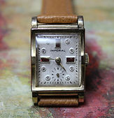 Imperial - Ruby and Diamond Dial - 10K R.G.P. Tank Case - 17 Jewels Wristwatch - (Circa 1950s)
