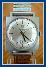 Jules Jurgenson - Square all Stainless Steel Case Swiss Made, Automatic Movement, and a Date feature located at the 6 o'clock position - Wristwatch - (circa 1960s)