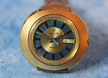 Elgin - Electronic Movement - Big Bold Barrel Case with a Colorful Blue Ringed Dial - Day and Date Wristwatch - (circa 1970s)