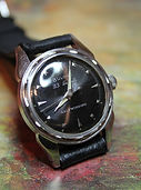 Bulova - USA Made - Black Starburst Dial - 23 Jewels with 6 Adjustments Automatic Movement Wristwatch - (circa 1957)