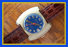 Lucerne - Barrel Shaped Brush Metal Case - Handsome Blue Round Dial - Raised Gold Tone Hour Markers Wristwatch - (circa 1970s)