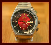 Orient - SK Crystal model - Too Cool Red Dial Dive Wristwatch with Day and Date - Rotating Bezel - 21 Jewel Automatic Movement - (circa 2010)