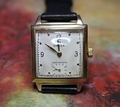 Omega - Square 14K G.F. Case - White Dial with Sunken Sub-Seconds Register at the 6 o'clock Position Wristwatch - (circa 1947)