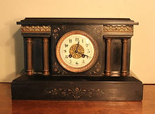 French - Black Marble Mantle Clock Featuring an Porcelain Dial and Fancy Carved Engravings - (circa 1890s)