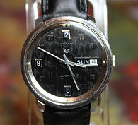 Elgin - Automatic All Stainless Steel with a Seldom Seen Corduroy Black Textured Dial Wristwatch - (circa 1960s)