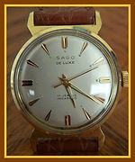 Sago, DeLuxe - Unusual T Lugs, 17 Jewels Mechanical Wind Movement Wristwatch - (circa 1950s)