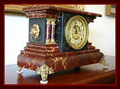 Gilbert - Mantle Clock Featuring an impressive swirling red, pink and white painted case - (circa 1880s)